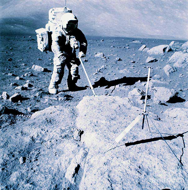 Apollo 17 astronaut collecting rocks on the moon