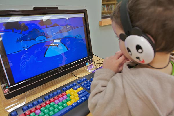 Kid on a Computer | Credit: https://www.flickr.com/photos/mikemcilveen/5454636825