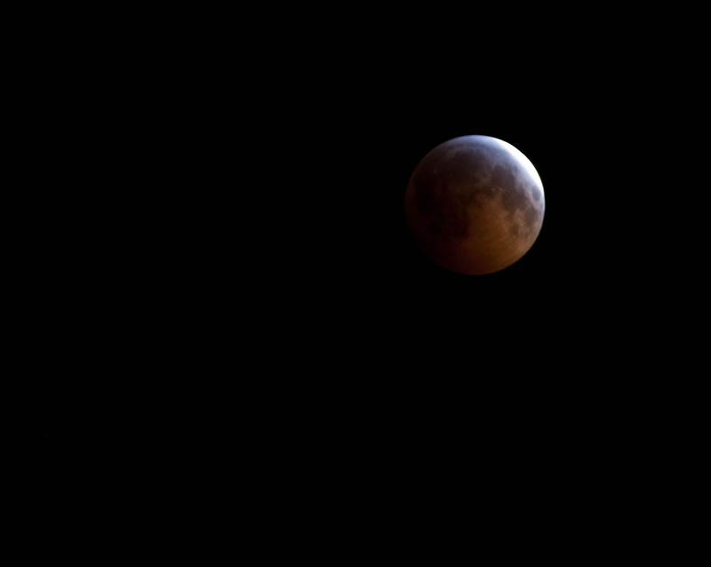 Lunar eclipse at full occlusion. Credit: Kevin Rank | https://www.flickr.com/photos/ryfter/5279833516