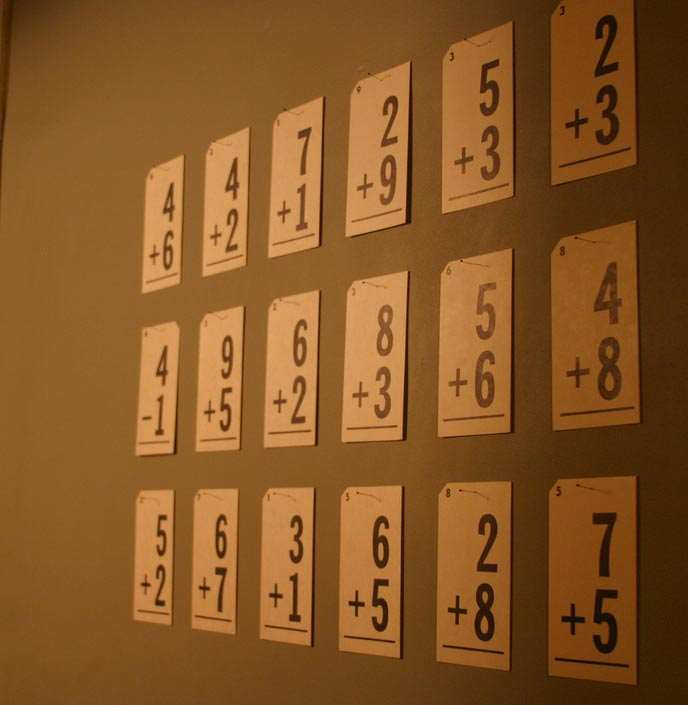 Math addition Flash Cards on a bulletin board