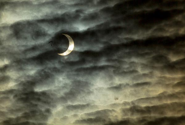 Skydiver adjacent to solar eclipse; photo taken in Nampa, Idaho, May 20, 2012 | Credit : Kevin Rank