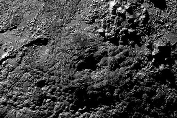 Wright Mons located just south of Sputnik Planum on Pluto is thought to be a massive ice volcano according to New Horizons scientists. | Credit: NASA/Johns Hopkins University/New Horizons