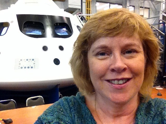 Joan Cartan-Hanse outside the Orion spacecraft at the Johnson Space Center, Houston. [Credit: Joan Cartan-Hansen]
