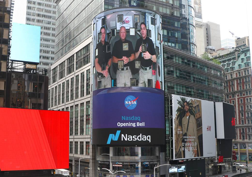 The Expedition astronauts on a digital billboard on Wall Street